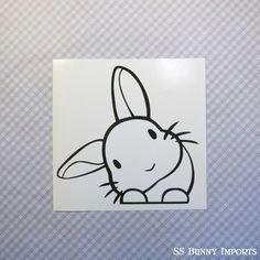 this cute little rabbit will watch everyone for you over its paws it is especially