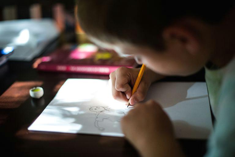 boy drawing cartoon person