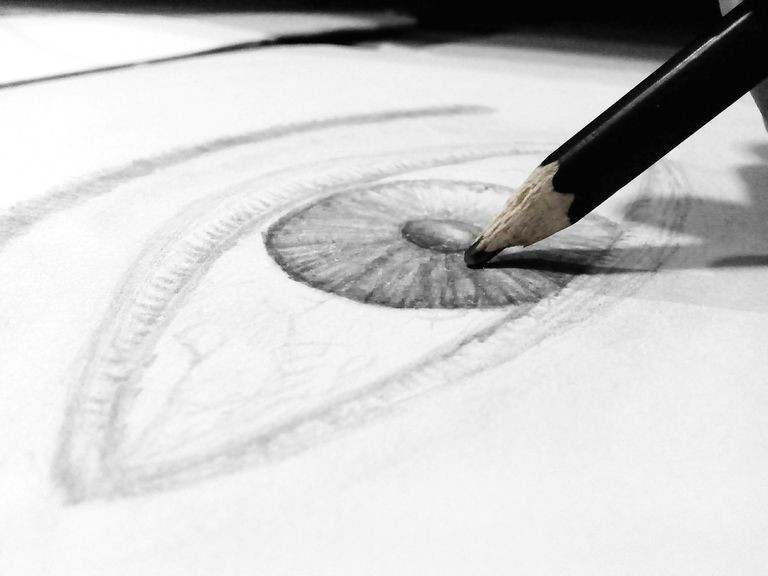 close up of human eye drawing on paper