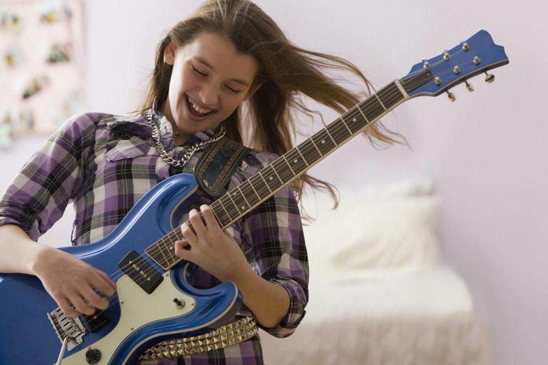 girl playing electric guitar