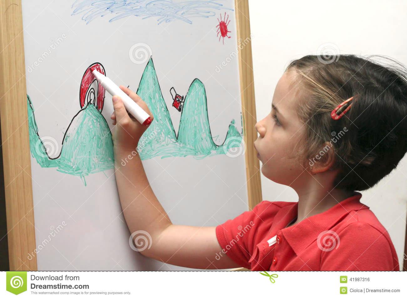 small girl drawing