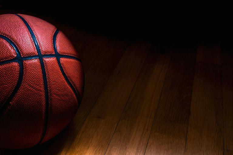 close up of basketball on hardwood floor