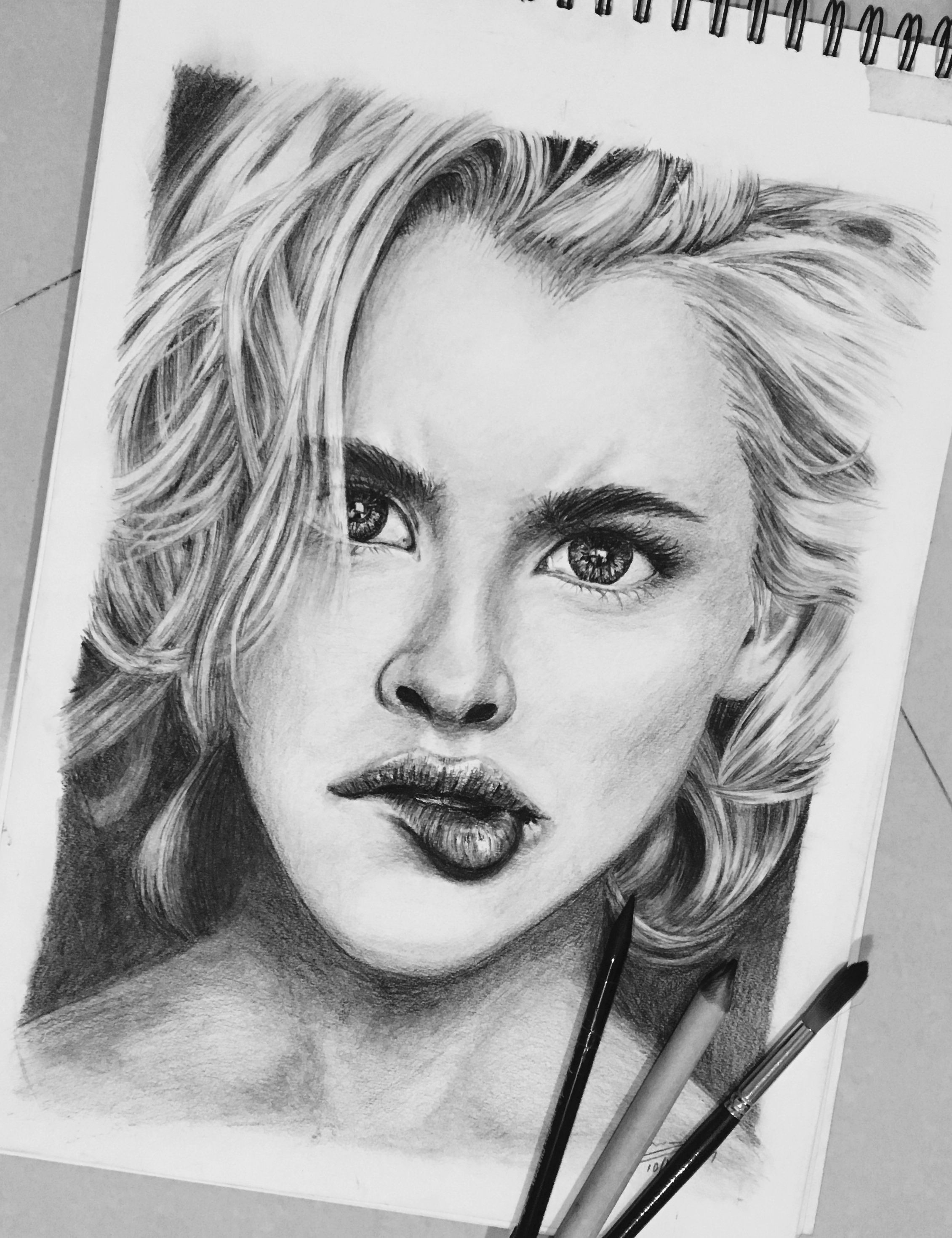 a charcoal pencil drawing done using mont marte woodless charcoal pencils doing blonde hair is a task with only a kneadable eraser