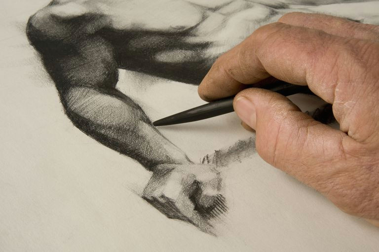 artist s hand and sketch