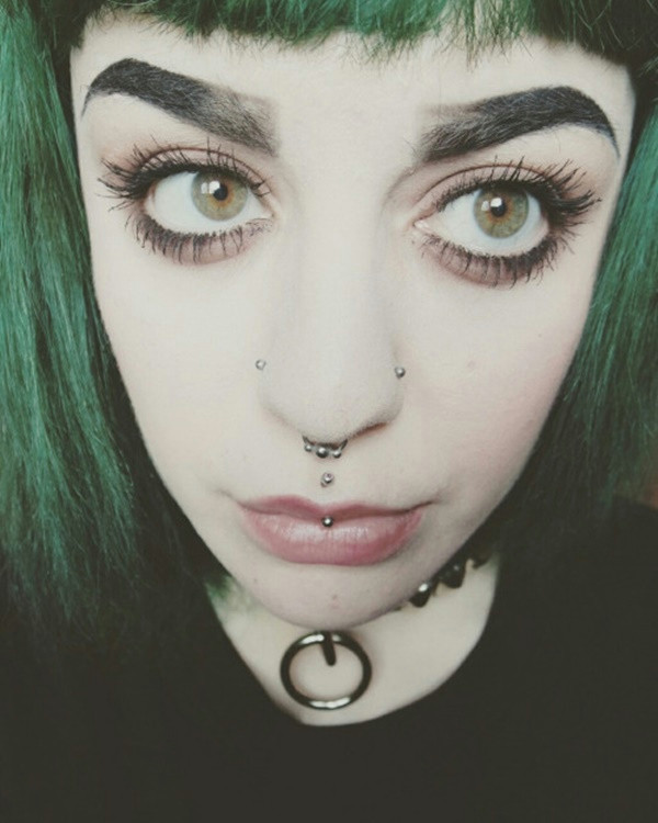 goth girls counting on beads double nose piercing