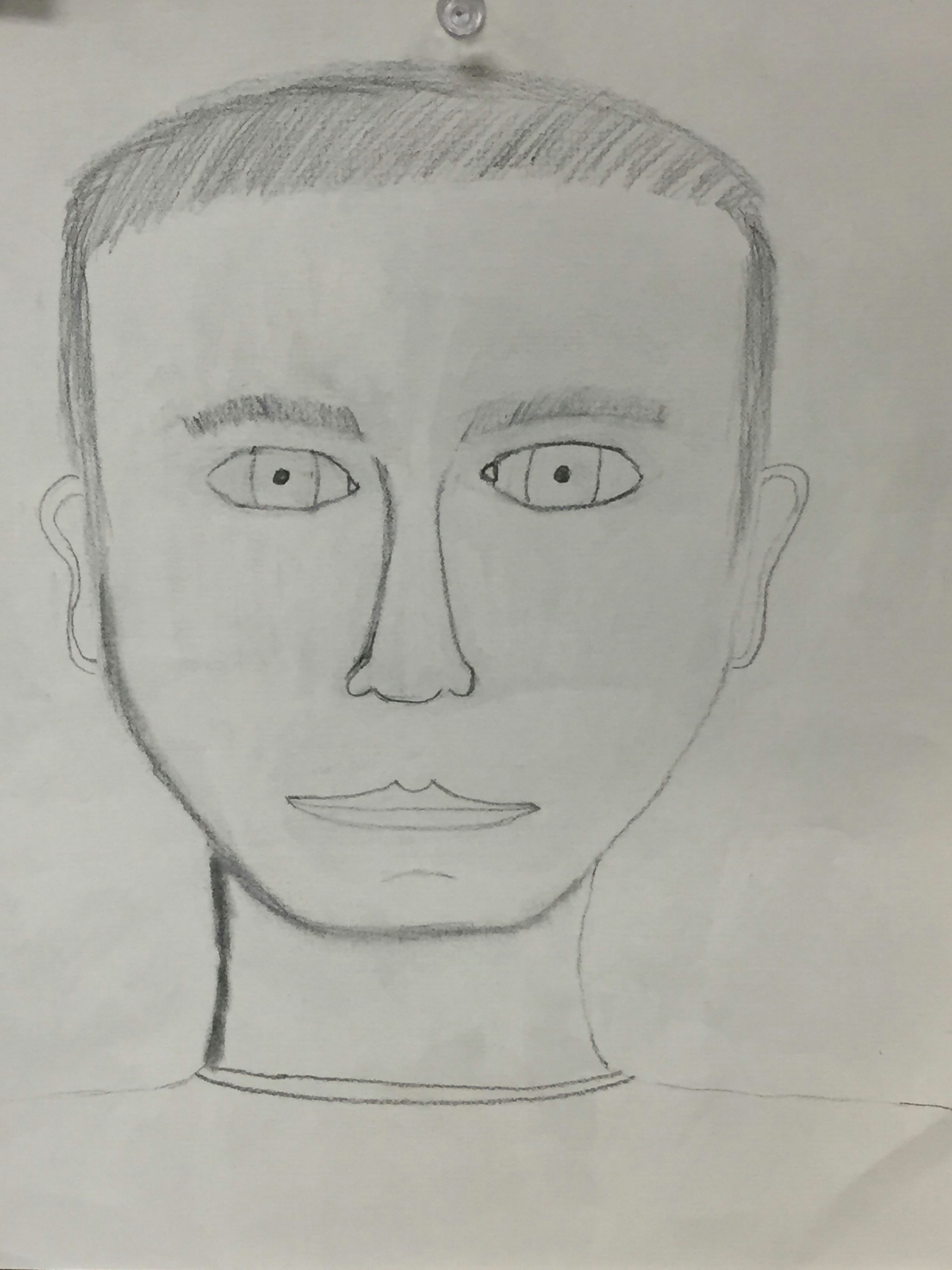 this is an unfinished self portrait i used pencil and divided it into three sections of the eyes nose and mouth