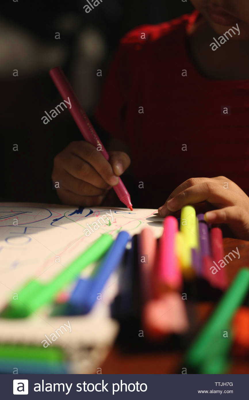 girl drawing with colored pencil on a drawing board ttjh7g jpg