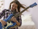 Drawing Girl Playing Guitar Best First songs to Learn On Electric Guitar